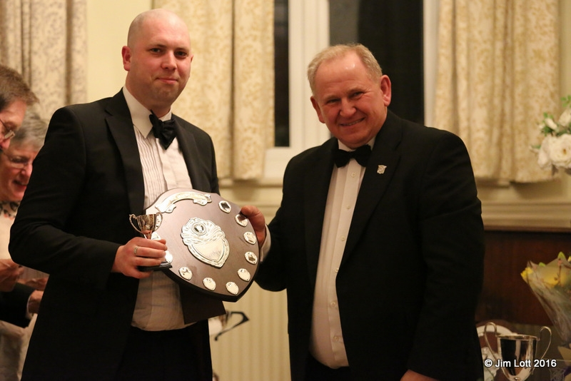 Ian Beningfield recieves the Class 3 (MG Midget) Championship award from Ian Quarrington.