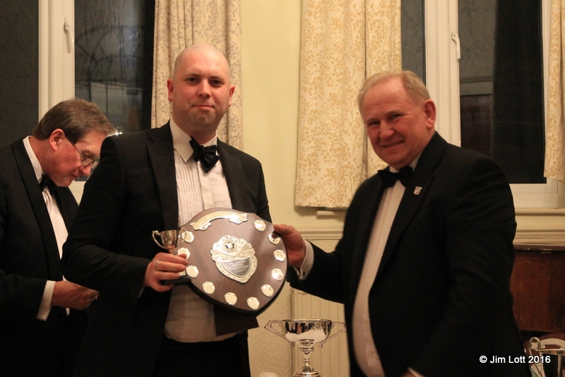 Ian Beningfield being awarded the SW Centre Championship Class 3 (MG Midget) shield by Ian Quarrington.