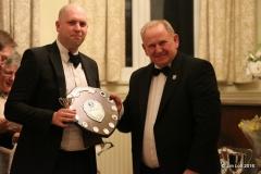 Ian Beningfield recieves the Class 3 (MG Midget) Championship award from Ian Quarrington.