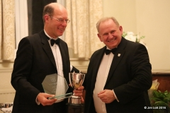 Dave Mothersdill being presented with the Drivers Championship Class 6 (FWD MGs) trophy.