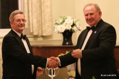 MG Car Club, SW Centre, Chairman, Jim Lott presenting Ian Quarrington MG Car Club Chairman with some MG engraved items as a 'thank you' for coming to enjoy the dinner and present the awards.