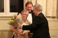 Sue Owst being presented with a bouquet of flowersfor her support to Andrew and the club.