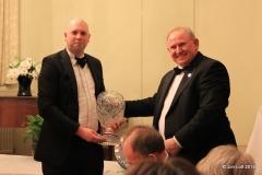 Ian Beningfield recieving the Luffield Sprint Championship, Overall Champion's trophy form Ian Quarrington.