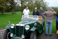 Andrew Owst, Steve Gardener, Edward Kirkland and Martin Lewis (with his back to the camera) discussing the finer points of Steve's MG TC