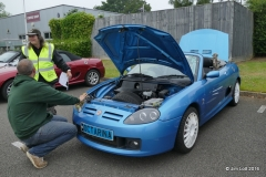 """Antony Pope with his Celestial Blue MG TF, """"Octarina"""" chatting to Carole Brown the assistant scrutineer."""