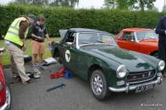 Matthew Walbran's (MGCC New Zealand) MG Midget. Andrew is chatting to Ian Beningfield about the best way to get the circlip back on the rear of the brake cylinder!