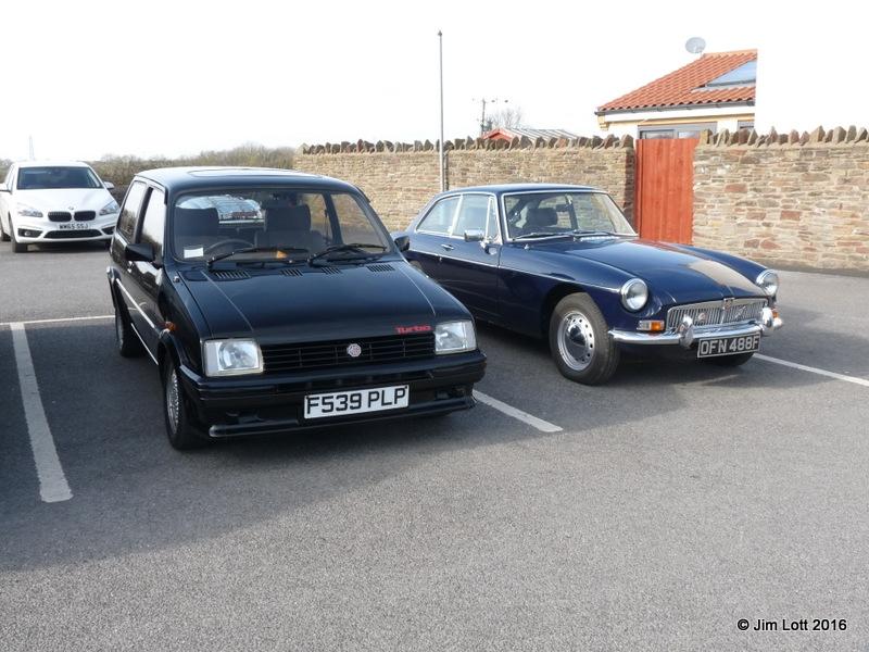 My Metro Turbo alongside Edward Kirklands's MGB GT