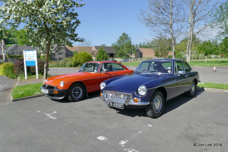 Clive and Helen Holloway's Orange MGB GT alongside Edward and Easter Kirkland's MGB GT