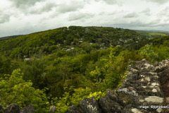 Panoramic view of valley showing the houses dotted on the valley side